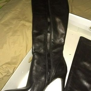 Black leather knee high boots.